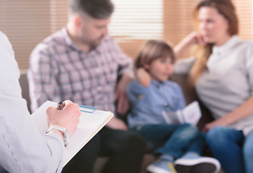 two parents and child at family mediation session