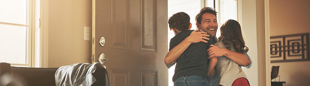 parent hugging children after divorce mediation
